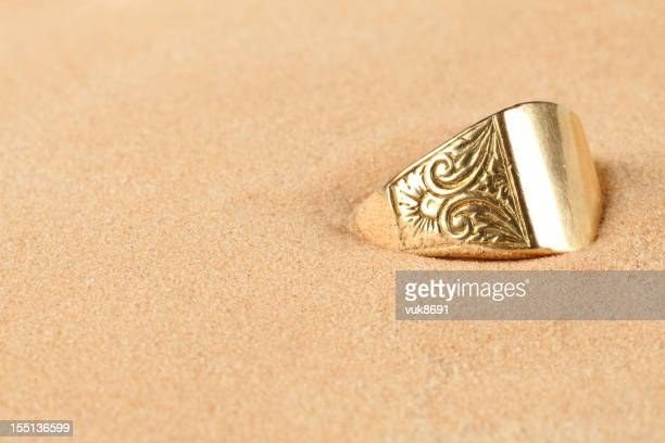 lost ring in the sand - buried stock pictures, royalty-free photos & images