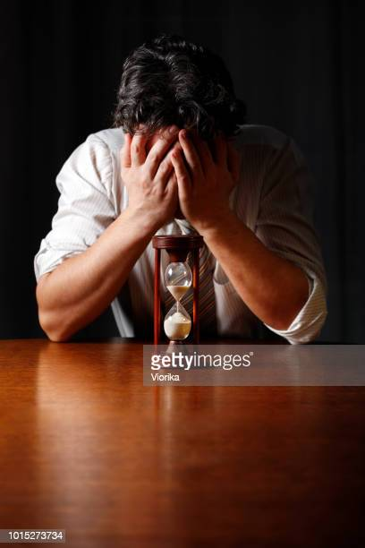 Lost Time (depressed businessman with an hourglass)