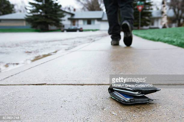 Lost wallet on sidewalk
