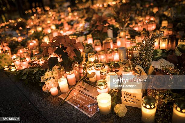 A lot of candles and flowers were put down at the memorial at the reopened Breitscheidplatz Christmas market only a short distance from where three...