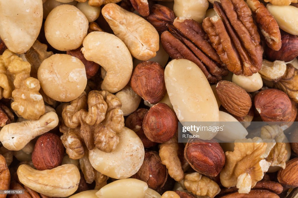 Lot Of Different Types Of Nuts Mix For Background Stock