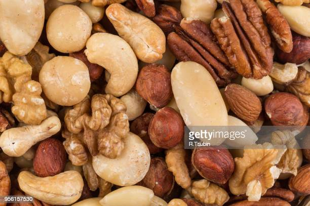 lot of different types of nuts mix for background - ナッツ類 ストックフォトと画像