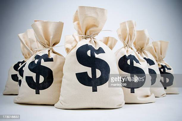 lot of money bags - money bag stock pictures, royalty-free photos & images