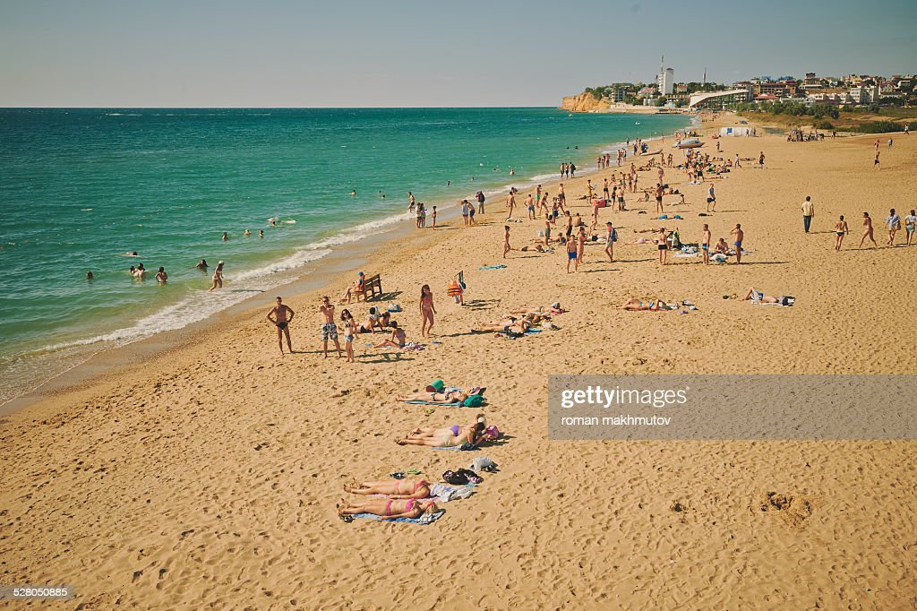 A Lot Of People Relaxing On Beach Stock Photo