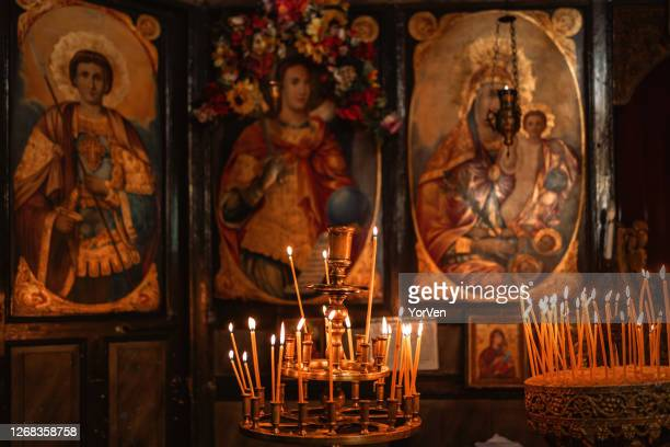 a lot of thick candles in the orthodox church temple near the altar - orthodox church stock pictures, royalty-free photos & images