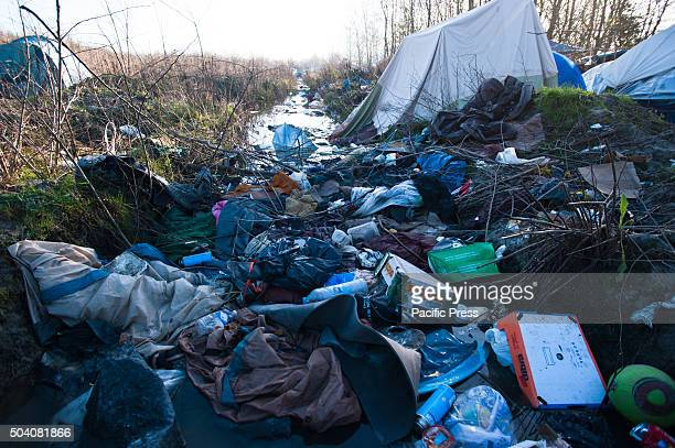 A lot of trash collects in the canals made to drain the water from the refugee camp in Dunkirk water flooded most of the tents after several days of...