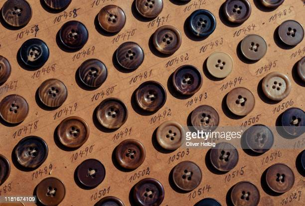 lot of vintage horn buttons on old cardboard from the 1930's - 裁縫道具 ストックフォトと画像