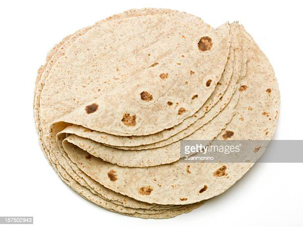 lot of whole wheat flour mexican tortillas - tortilla flatbread stock photos and pictures
