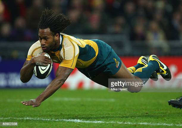 Lote Tuqiri of Australia dives over for the first try of the match during the 1908 2008 London Olympic Centenary match between The Barbarians and...
