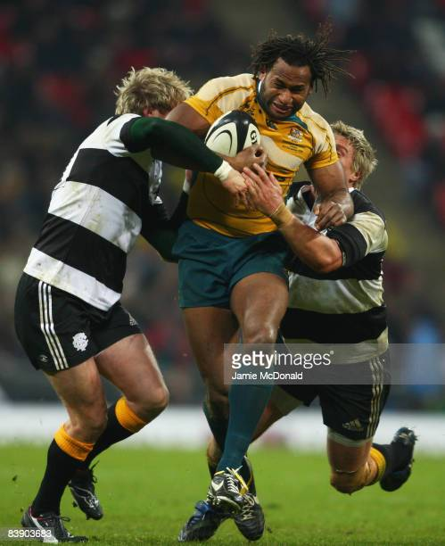 Lote Tuqiri of Australia is tackled by Ollie Smith and Jean De Villiers of The Barbarians during the 1908 2008 London Olympic Centenary match between...