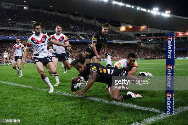Lote Tuqiri of the Tigers dives over to score a try during the NRL Second Qualifying Final match between the Wests Tigers and the Sydney Roosters at...