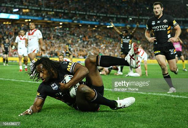 Lote Tuqiri of the Tigers scores the opening try against the Dragons during the Second NRL Preliminary Final match between the St George Illawarra...