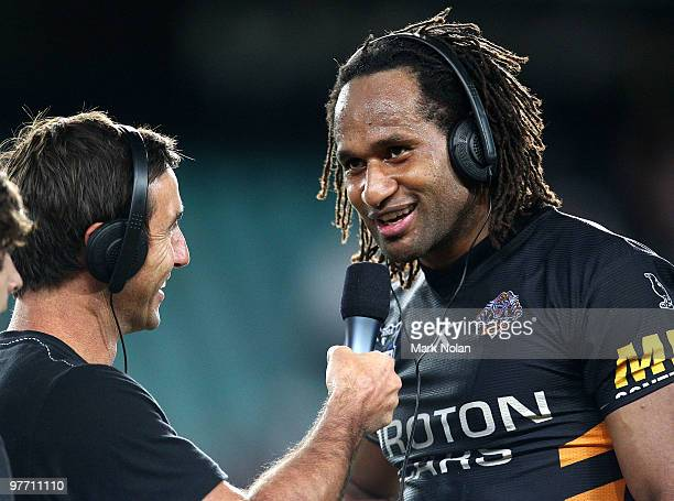 Lote Tuqiri of the Tigers talks to Andrew Johns after the round one NRL match between the Wests Tigers and the Manly Warringah Sea Eagles at the...