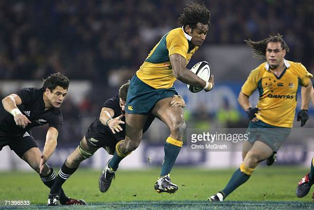 Lote Tuqiri of the Wallabies makes a break during the Tri Nations series Bledisloe Cup match between the New Zealand All Blacks and the Australian...
