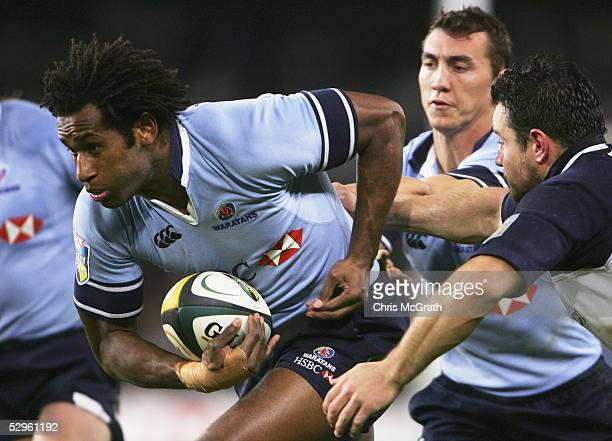 Lote Tuqiri of the Waratahs makes a break during the Super 12 semi final match between the New South Wales Waratahs and the Bulls at Aussie Stadium...