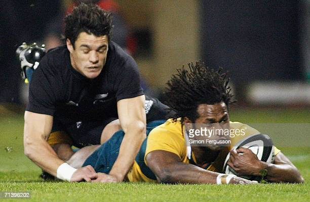Lote Tuqiri scores the first try breaking past Daniel Carter during the Tri Nations series Bledisloe Cup match between the New Zealand All Blacks and...