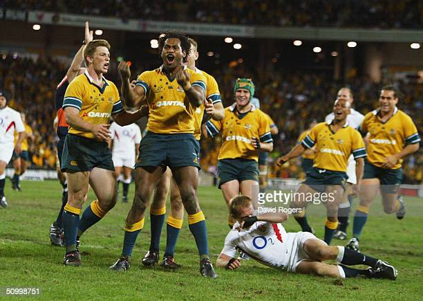 Lote Tuqiri, the Australian wing, celebrates after scoring a try during the rugby union international match between the Australian Wallabies and...