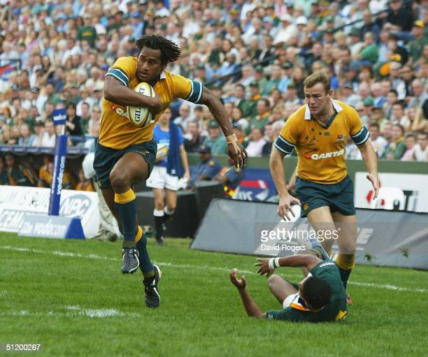 Lote Tuqiri the Australian wing races away to score the first tryduring the Tri-Nations Rugby Union International between South Africa and Australia...