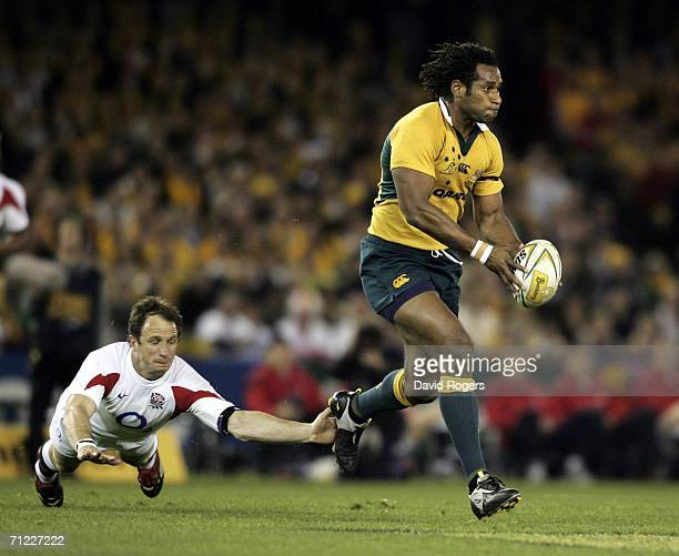 Lote Tuqiri the Wallaby wing races away from Mike Catt during the second Cook Cup match between the Australian Wallabies and England played at the...