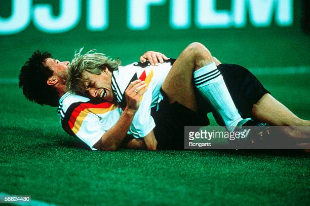 Lothar Mattaeus and Juergen Klinsmann of Germany celebrate after the first goal for Germany during the World Cup match between Germany and Yugoslavia...