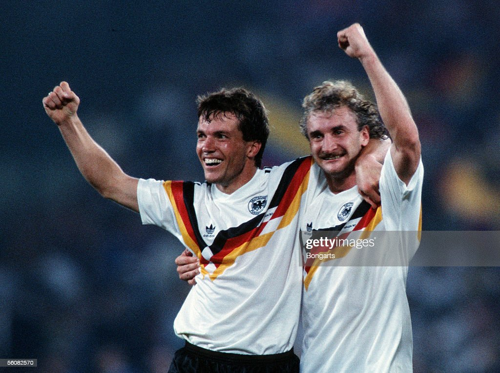Lothar Matthaeus and Rudi Voeller of Germany celebrate the victory over Argentina in the World Cup final match in the Olympic Stadium on July 8, 1990 in Rome, Italy.