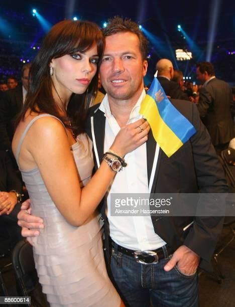 Lothar Matthaeus attends with Kristina Liliana the WBO, IBF & IBO Heavyweight title fight between Wladimir Klitschko of Ukraine and Ruslan Chagaev of...