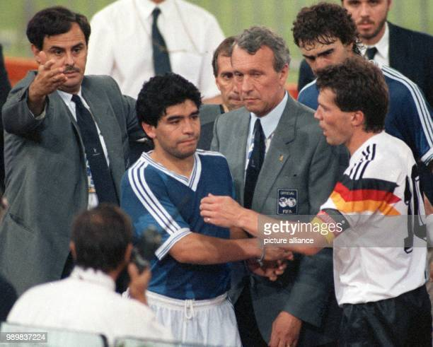 Lothar Matthaeus captain of the German national soccer team shakes hands with his Argentinian counterpart Diego Maradona and has some words of...