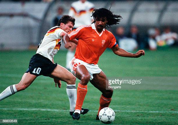 Lothar Matthaeus of Germany and Ruud Gullit of Netherlands battle for the ball during the World Cup eighth final match between Germany and...