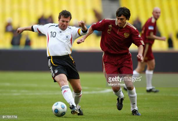 Lothar Matthaeus of Germany battles for the ball during the Legends match between Russia and Germany at the Luzhniki Stadium on October 10 2009 in...