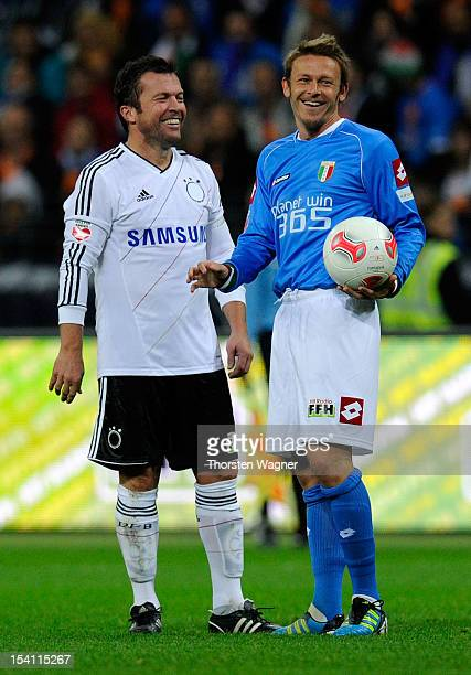 Lothar Matthaeus of Germany smile with Roberto Baggio of Italy during the century match between Germany and Italy at Commerzbank Arena on October 14...