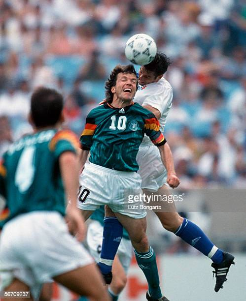 Lothar Matthaeus of Germany wins the ball in the air during the US Cup match between Germany and USA on June 13 1993 in Chicago United States