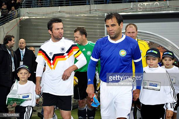 Lothar Matthaeus of the World Champion 1990 and Ulf Kirsten of the DFV Legend enter the pitch before the Reunification match between the World...