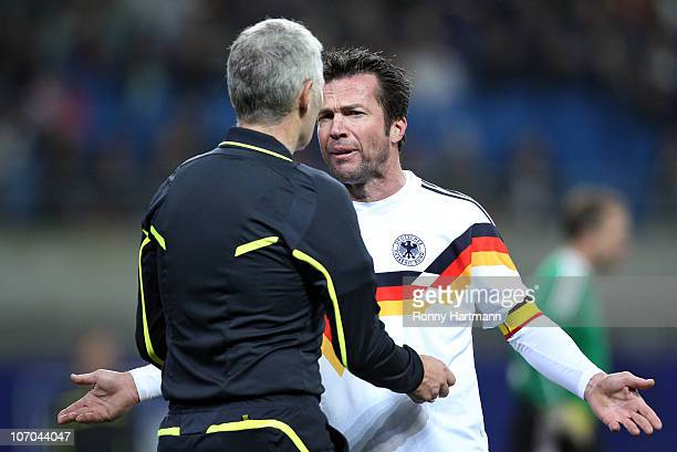 Lothar Matthaeus of the World Champion 1990 discusses with Lutz Michael Froehlich during the Reunification match between the World Champion 1990 and...