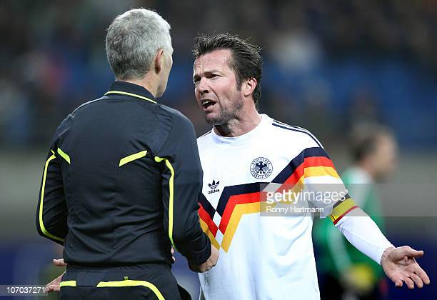 Lothar Matthaeus of the World Champion 1990 discusses with referee Lutz Michael Froehlich during the Reunification match between the World Champion...