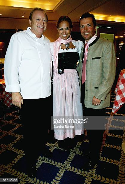 Lothar Matthaeus poses for a photo with his wife Marijana and Alfons Schubeck at the Arabella Sheraton Hotel on September 17 2005 in Munich Germany...