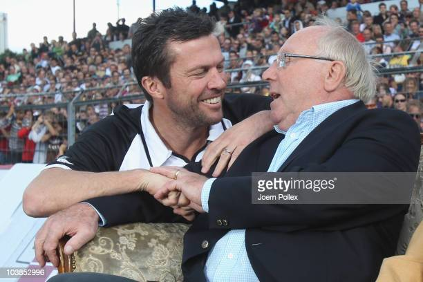 Lothar Matthaeus talks to Uwe Seeler prior to the Day of Legends match between team Germany and the rest of the world and team Hamburg at the...