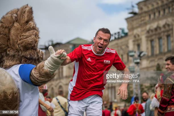 Lothar Matthaus is being greeted by Zabivaka during the Legends Football Match in Red Square on July 11 2018 in Moscow Russia