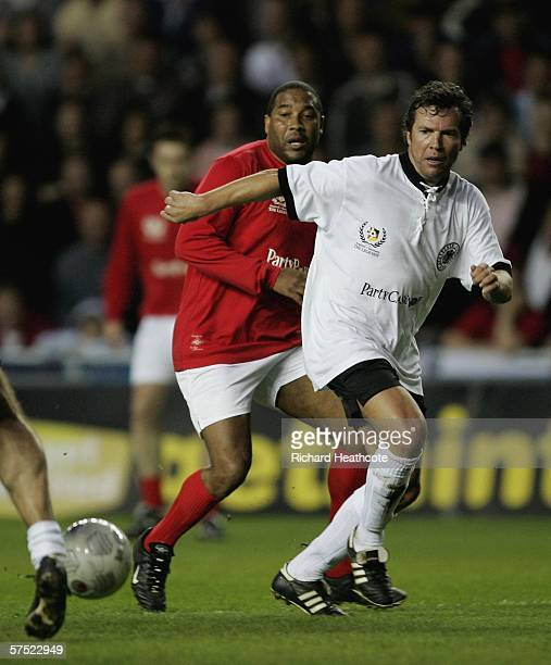 Lothar Matthaus of Germany blocks John Barnes of England during the Legends match between England and Germany at The Madejski Stadium on May 3 2006...