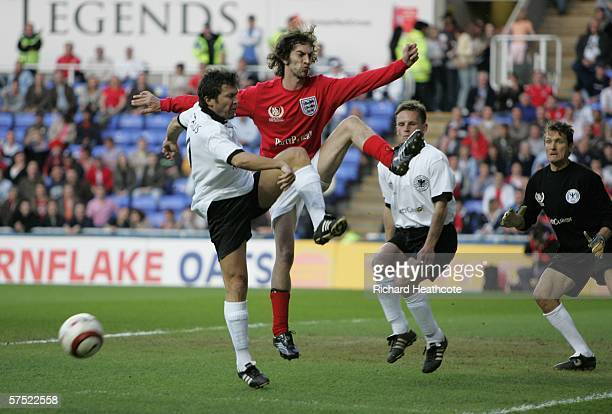 Lothar Matthaus of Germany blockss Richard Ashcroft of England during the Legends match between England and Germany at The Madejski Stadium on May 3...