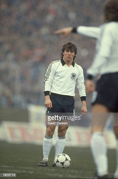 Lothar Matthaus of West Germany discusses tactics with a team mate during a match Mandatory Credit David Cannon/Allsport