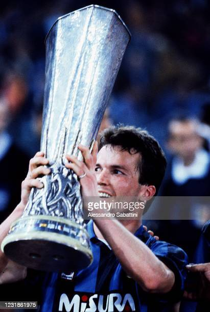 Lothar Matthäus of FC Internzaionale celebrates the victory with the trophy after the Uefa Cup 1990-91 match between FC Internazionale and AS Roma at...