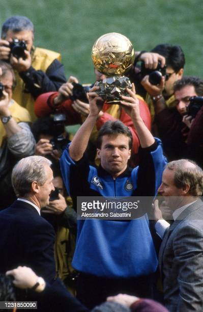 Lothar Matthäus of FC Internzaionale with his coach Giovanni Trapattoni , Hans Hubert Vogts celebrates in Milan after winning the golden ball during...