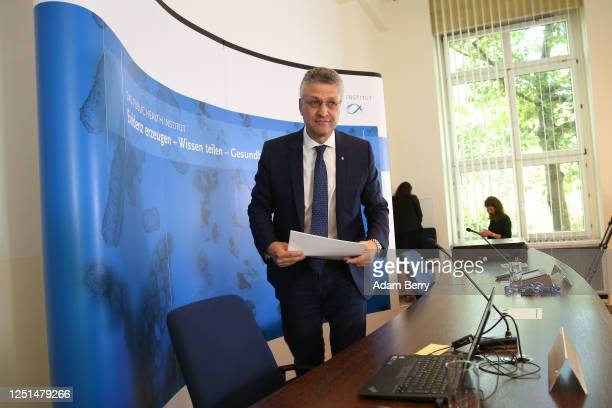 Lothar Wieler, president of the Robert Koch Institute , a public research institute responsible for disease control, leaves the room after speaking...