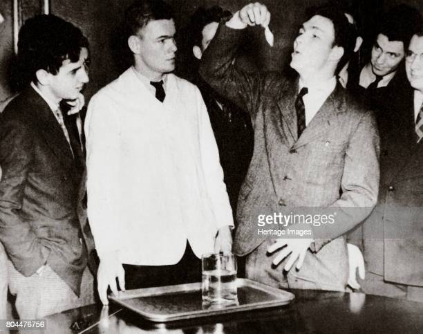 Lothrop Withington Jr a Harvard freshman swallowing a goldfish USA 1935 Three days later at Franklin and Marshall College a young man ate three The...