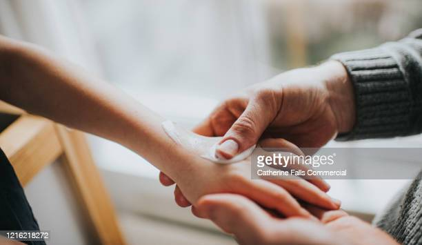 lotion on hand - healthcare and medicine stock pictures, royalty-free photos & images