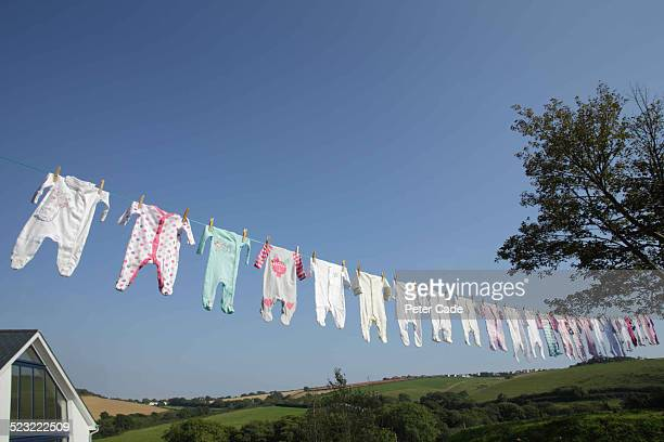Lots of baby grows on a washing line