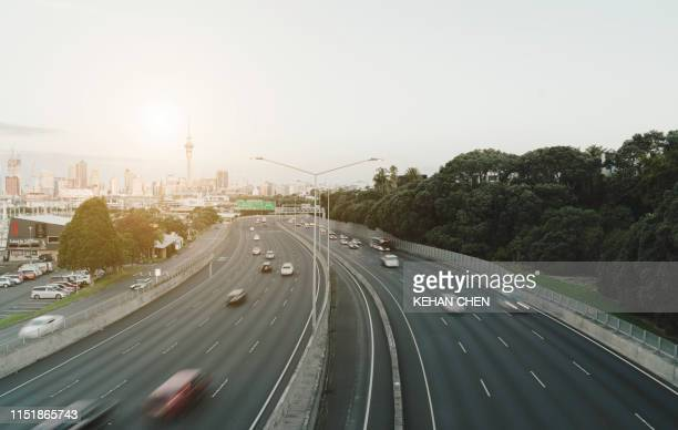 lots of cars and vehicle in highway in auckland city - autonomous technology stock pictures, royalty-free photos & images