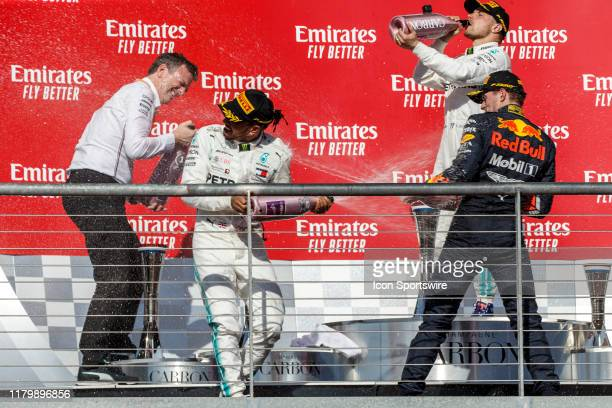 Lots of champagne sprayed as the winners celebrate after the podium ceremonies at the F1 United States Grand Prix held November 3 at the Circuit of...