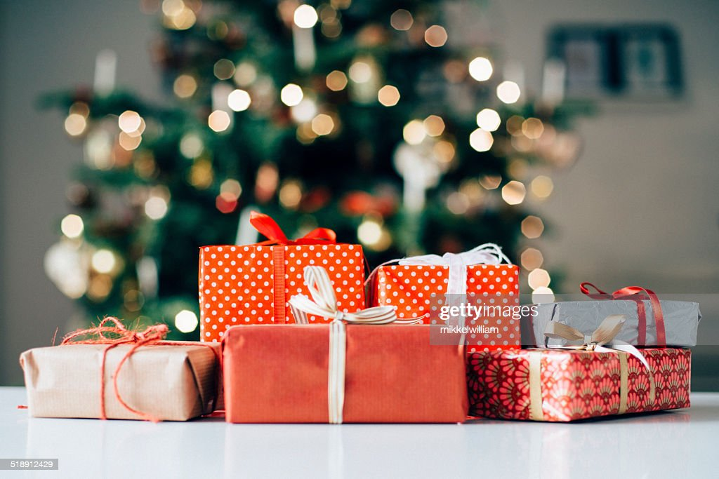 Lots of christmas presents on a table : Stock Photo
