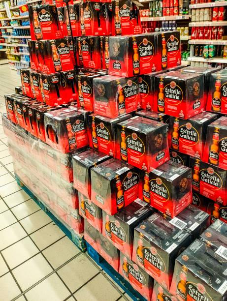 Lots of Estrella Galicia brand beer in a super market